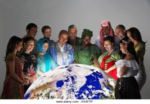 multi-ethnic-people-in-traditional-dress-looking-at-globe-ax4f7p